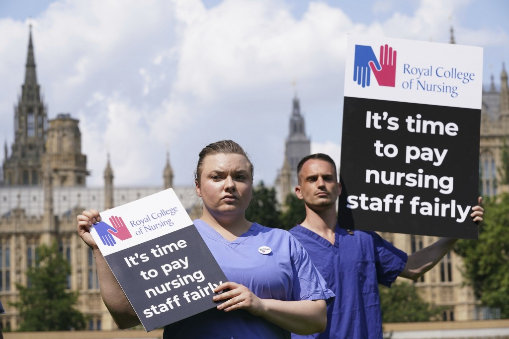 Nurses hold placards outside the Royal College of Nursing (RCN) in Victoria Tower Gardens, London, Wednesday July 21, 2021. In a statement Wednesday J...