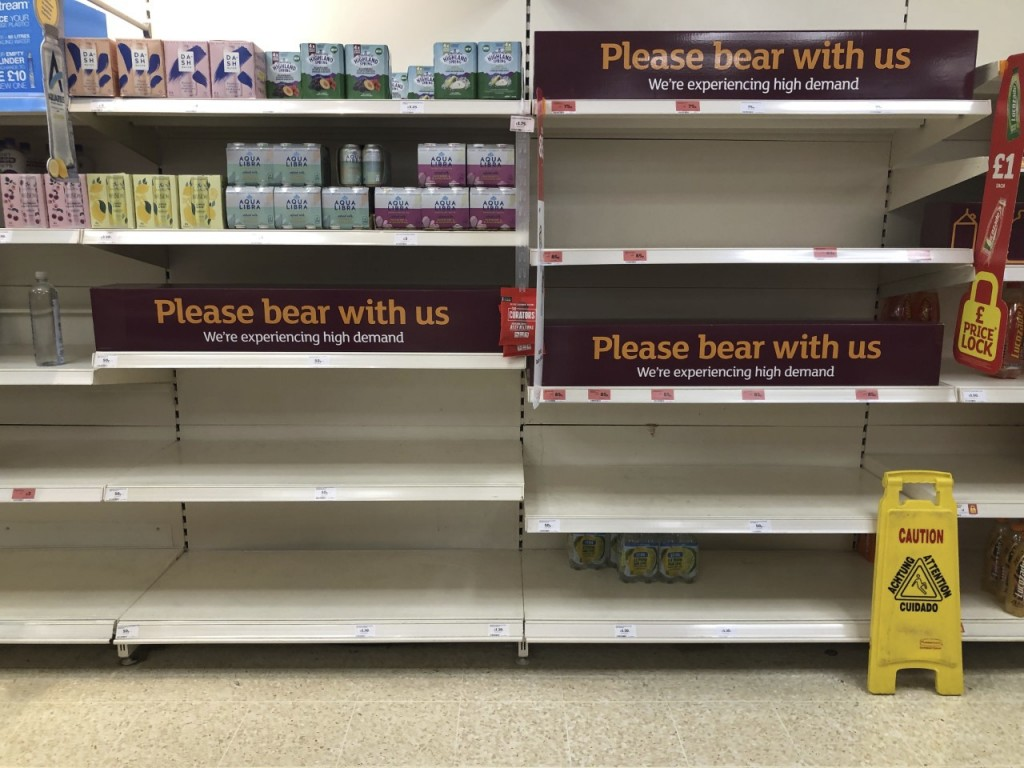 Empty shelves and signs on the soft drinks aisle of a Sainsbury's store in Rowley Regis in the West Midlands, England, Thursday July 22, 2021. Retaile...