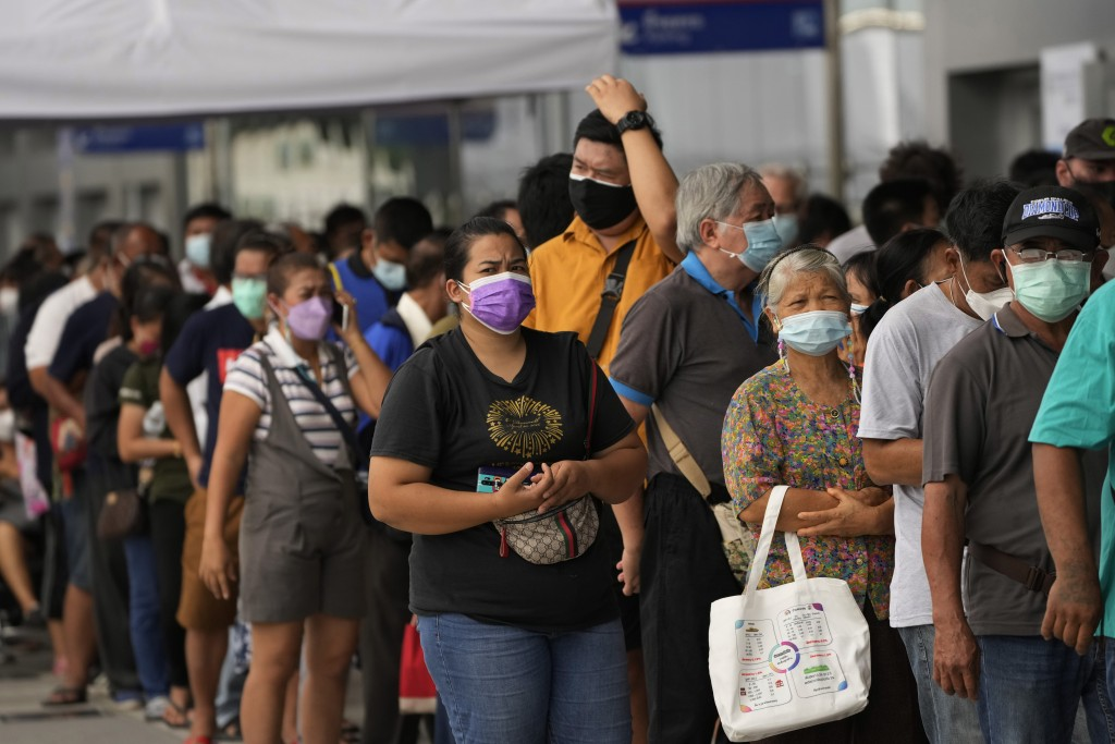 Residents wait on line to receive shots of the AstraZeneca COVID-19 vaccine at the Central Vaccination Center in Bangkok, Thailand, Thursday, July 22,...