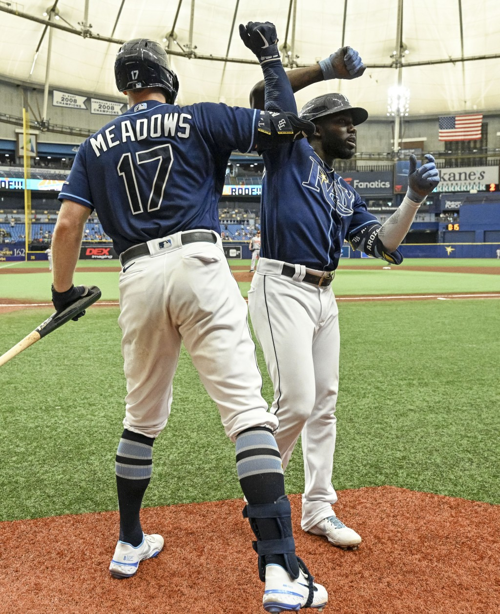 Tampa Bay Rays' Randy Arozarena celebrates with Austin Meadows (17) after hitting a solo home run off Baltimore Orioles starter Alexander Wells during...