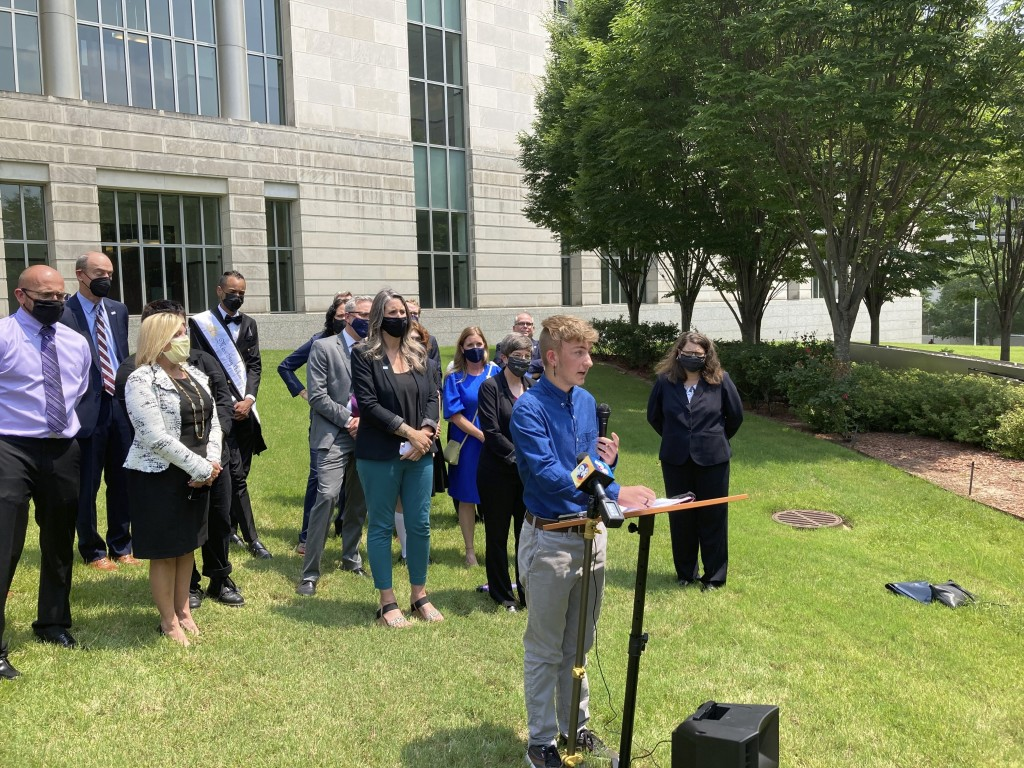 Dylan Brandt speaks at a news conference outside the federal courthouse in Little Rock, Ark., on Wednesday, July 21, 2021. Brandt, 15, has been receiv...