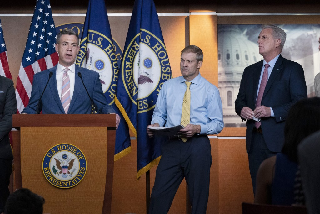 Rep. Jim Banks, R-Ind., speaks during a news conference as Rep. Jim Jordan, R-Ohio, and House Minority Leader Kevin McCarthy, R-Calif., looks on at Ca...