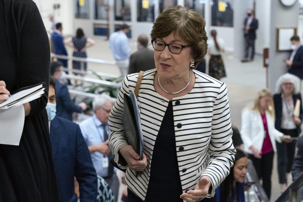 Sen. Susan Collins, R-Maine, talks to reporters as she walks to the Senate chamber ahead of a test vote scheduled by Democratic Leader Chuck Schumer o...