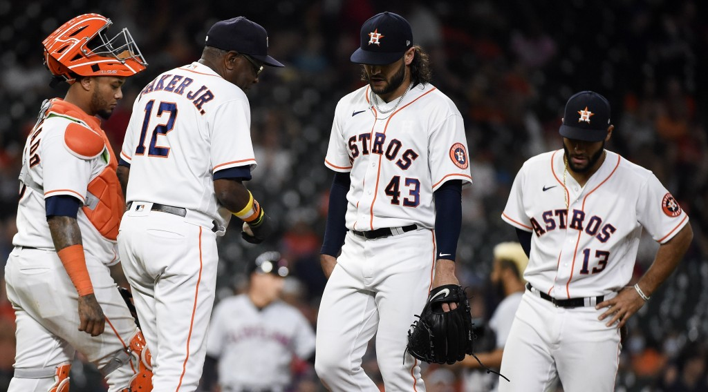 Houston Astros starting pitcher Lance McCullers Jr. (43) is removed from the baseball game by manager Dusty Baker Jr. (12) during the fifth inning aga...