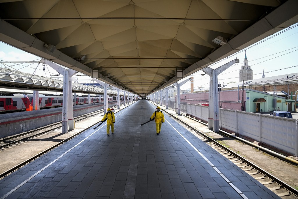 Employees of the Russian Emergency Situations disinfect a platform of Liningradsky railway station in Moscow in Moscow, Russia, Thursday, July 22, 202...
