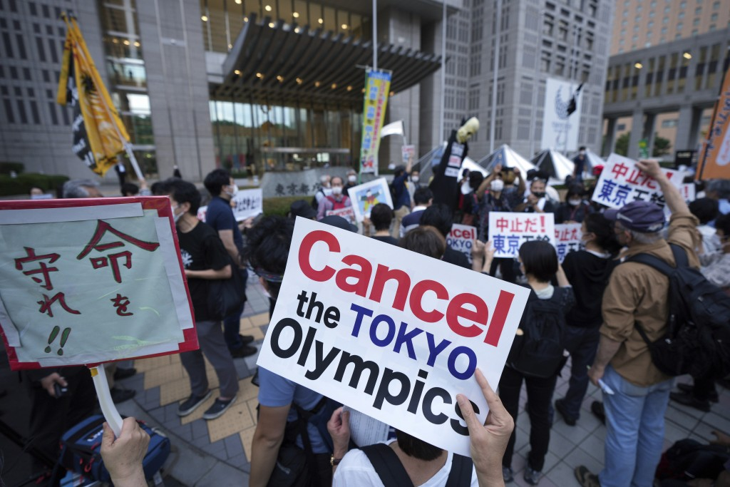 FILE - In this  June 23, 2021, file photo, people against the July opening of the Tokyo 2020 Olympics, gather to protest around the Tokyo Metropolitan...