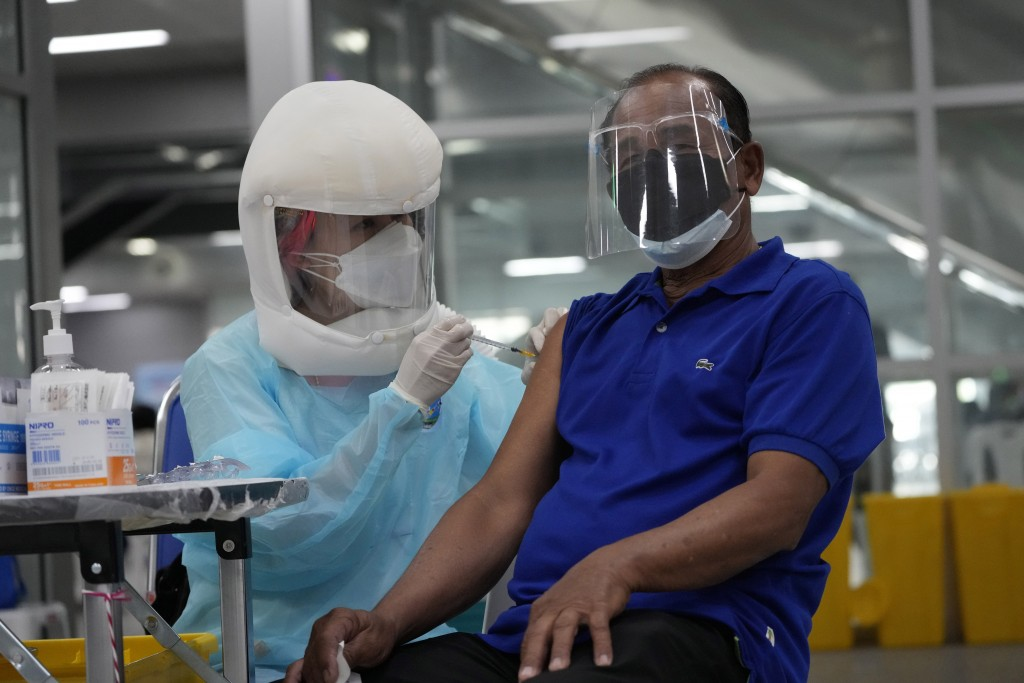 A health worker administers shots of the AstraZeneca COVID-19 vaccine at the Central Vaccination Center in Bangkok, Thailand, Thursday, July 22, 2021....