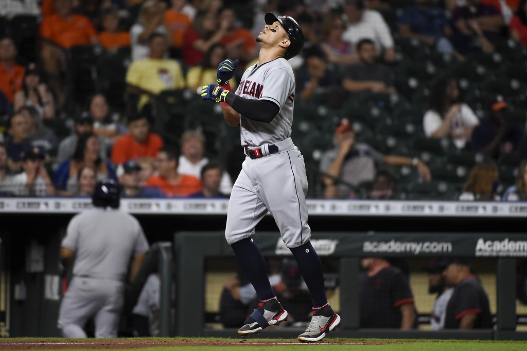 Cleveland Indians' Cesar Hernandez celebrates his solo home run during the seventh inning of a baseball game against the Houston Astros, Wednesday, Ju...