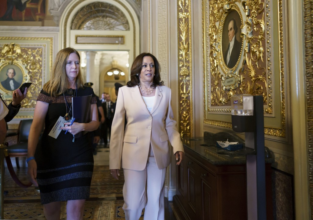Vice President Kamala Harris arrives at the Senate to break any tie votes as the Senate prepares to hold a procedural vote on infrastructure, at the C...
