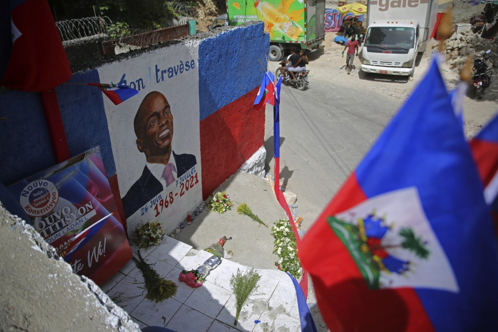 A freshly painted mural of late President Jovenel Moise covers a wall in the Kenscoff neighborhood of Port-au-Prince Haiti, Wednesday, July 21, 2021. ...