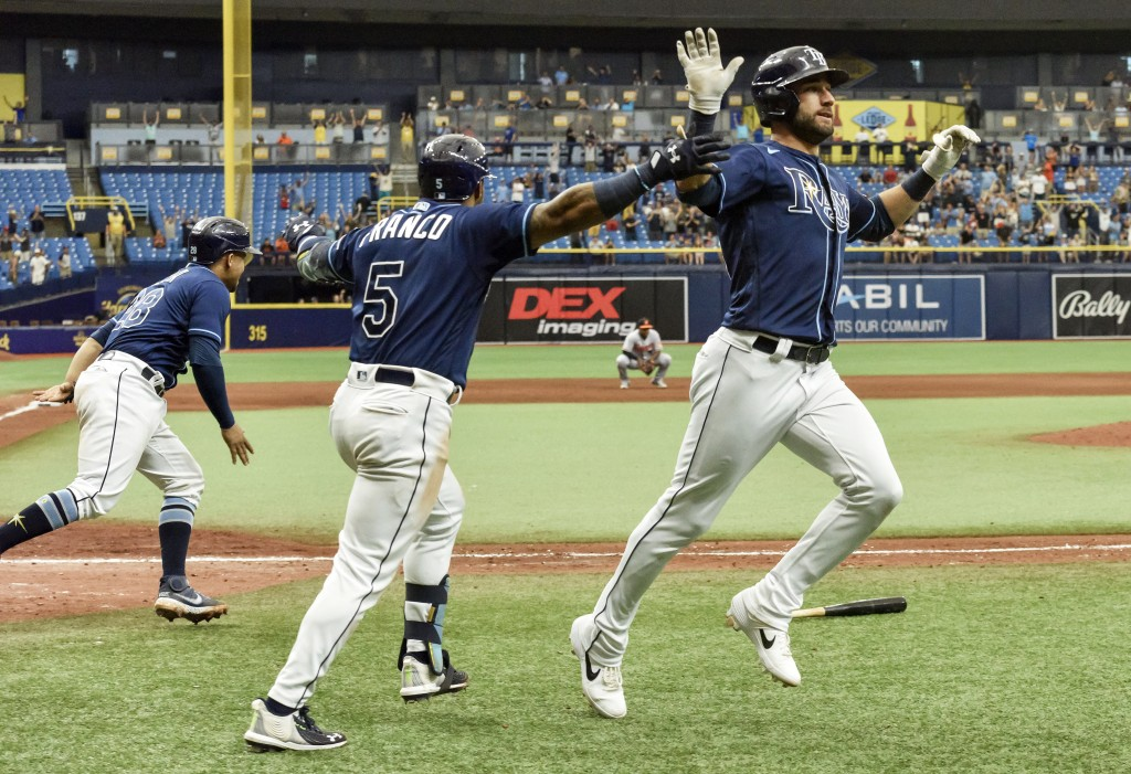 Tampa Bay Rays' Francisco Mejia, left, Wander Franco (5) and Kevin Kiermaier celebrate after a walk-off, two-run single by Austin Meadows beat the Bal...