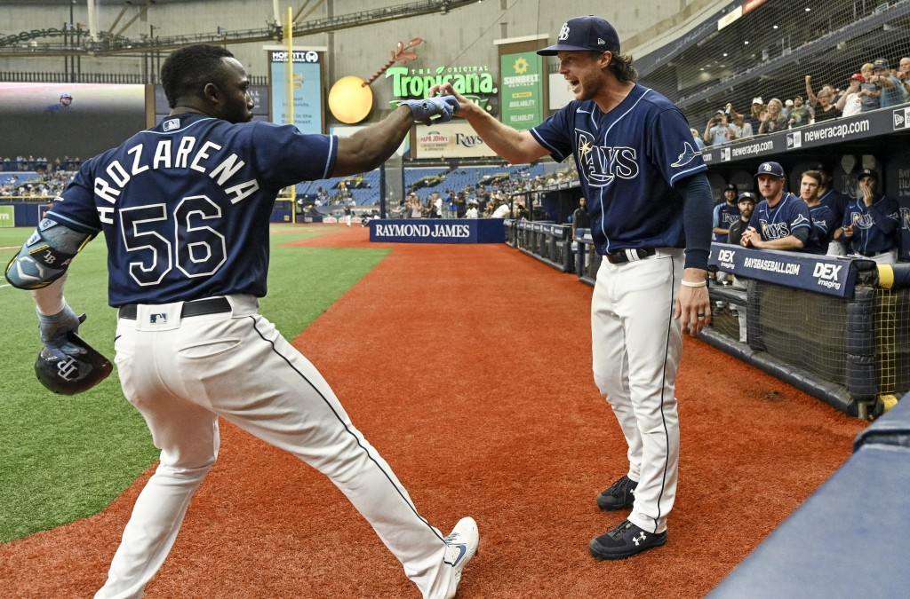 Tampa Bay Rays' Randy Arozarena (56) celebrates with Brett Phillips after hitting a solo home run off Baltimore Orioles starter Alexander Wells during...