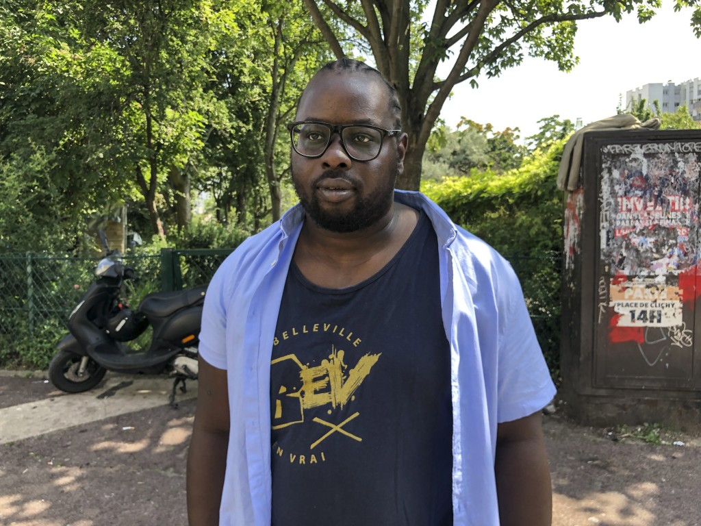 Issa Coulibaly, head of Pazapas, a youth association in eastern Paris poses during an interview of the Associated-Press in Paris, Wednesday, July 21, ...