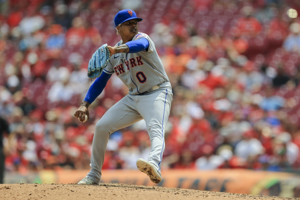 New York Mets' Marcus Stroman throws during the seventh inning of a baseball game against the Cincinnati Reds in Cincinnati, Wednesday, July 21, 2021....