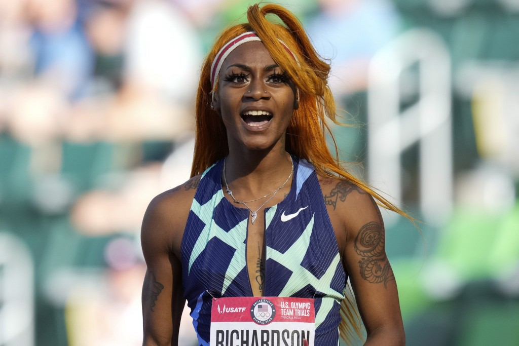 FILE - In this June 19, 2021, photo, Sha'Carri Richardson celebrates after winning the first heat of the semis finals in women's 100-meter run at the ...