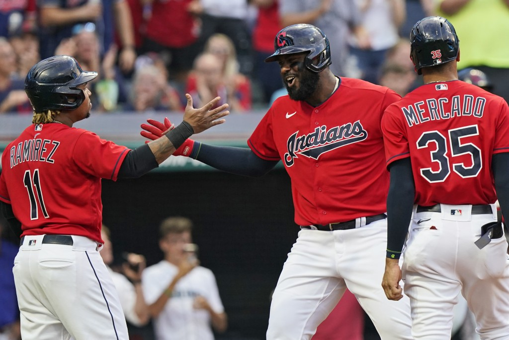 Cleveland Indians' Franmil Reyes, center, is congratulated by Jose Ramirez and Oscar Mercado after hitting a three-run home run in the third inning of...