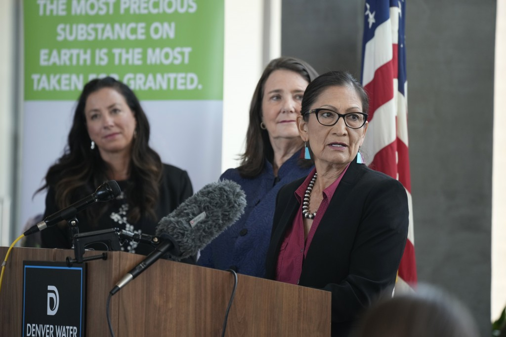 Interior Secretary Deb Haaland responds to a question as Becky Mitchell, left, of the Colorado Water Conservation Board, and U.S. Rep Diana DeGette, D...