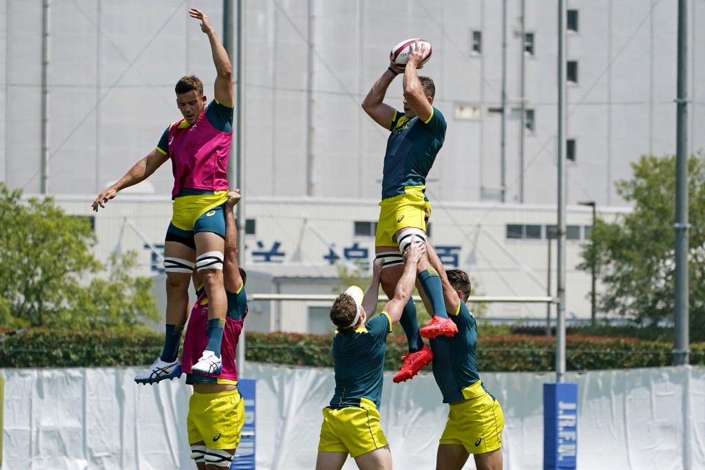 Members of Australia's men's rugby sevens team hold a practice at the Tokyo 2020 Olympics, in Tokyo, Friday, July 23, 2021. (AP Photo/David Goldman)