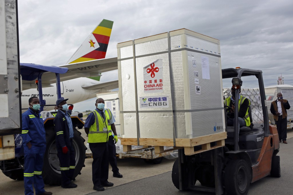 FILE - In this Monday, Feb, 15, 2021 file photo, a forklift carries a pallet of the Sinopharm COVID-19 vaccine from China upon its arrival at Robert M...