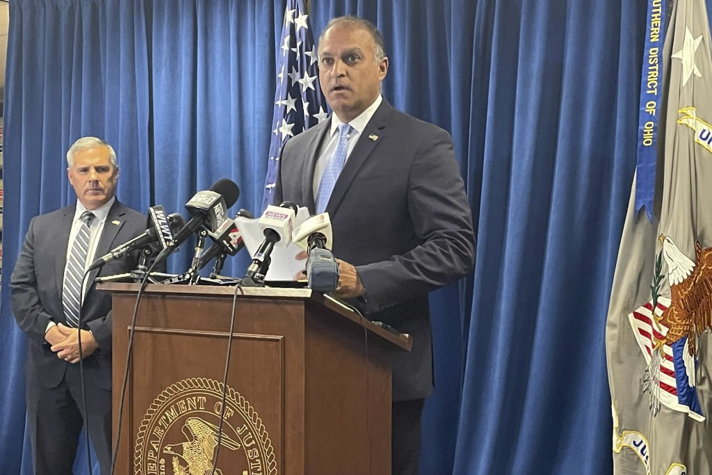 Acting U.S. Attorney Vipal J. Patel, center, accompanied by FBI Special Agent in Charge Chris Hoffman, speaks during a news conference in Cincinnati, ...
