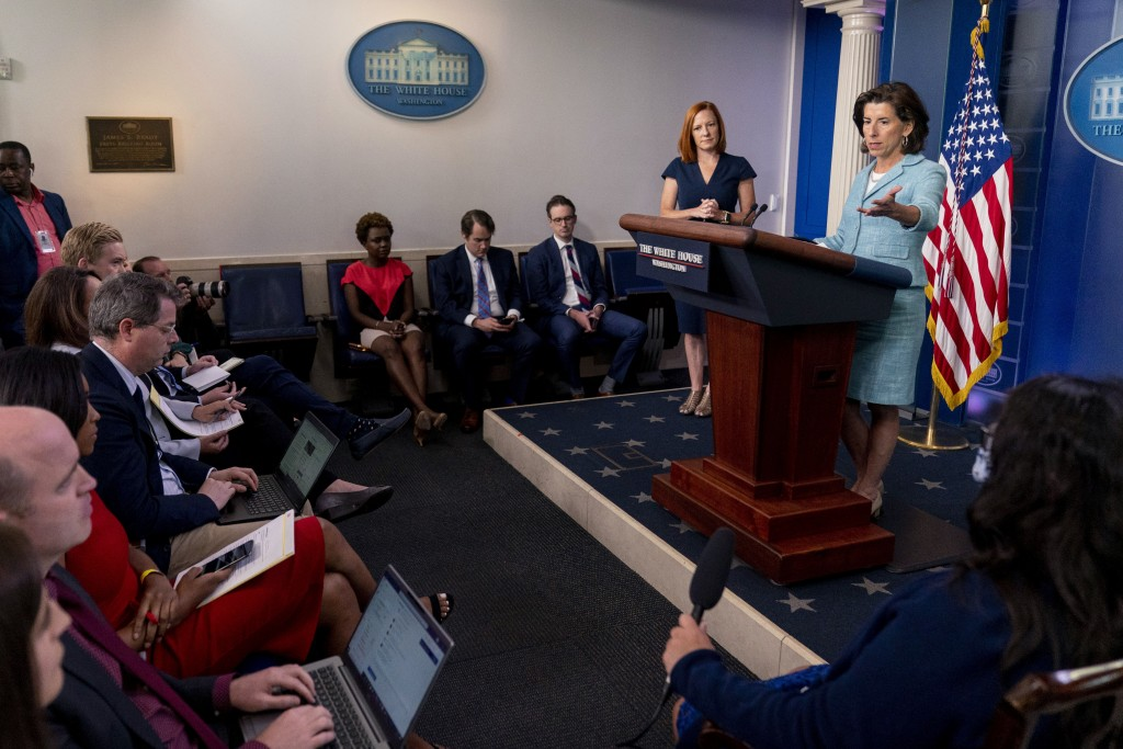 Commerce Secretary Gina Raimondo, accompanied by White House press secretary Jen Psaki, second from right, speaks during a press briefing in the brief...