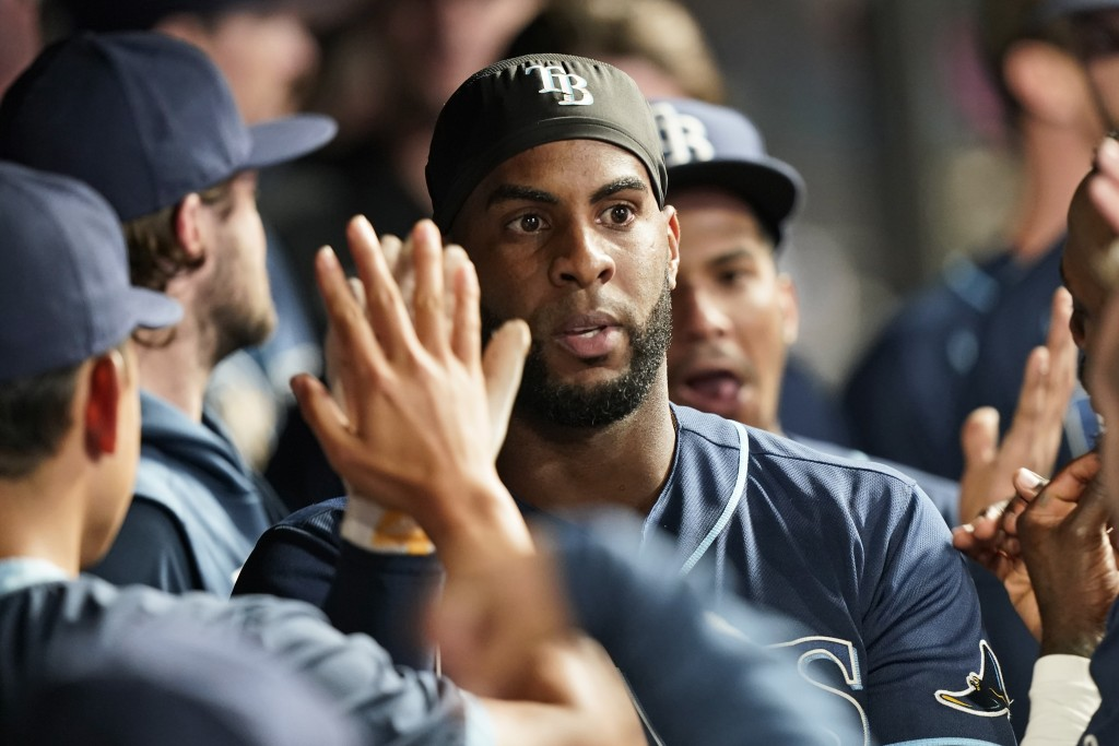 Tampa Bay Rays' Yandy Diaz celebrates with teammates after hitting a solo home run in the ninth inning of a baseball game against the Cleveland Indian...