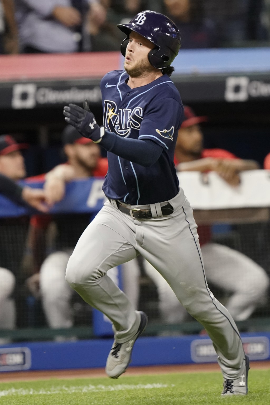 Tampa Bay Rays' Brett Phillips heads home to score during the ninth inning of the team's baseball game against the Cleveland Indians, Thursday, July 2...