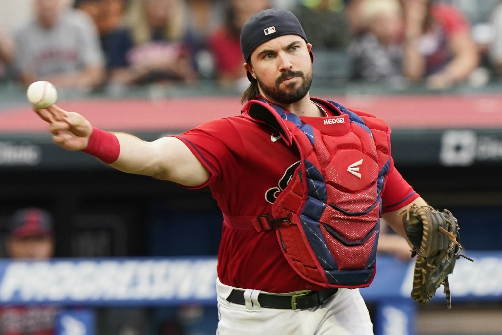 Cleveland Indians catcher Austin Hedges throws out Tampa Bay Rays' Austin Meadows at first base after a dropped third strike during the third inning o...