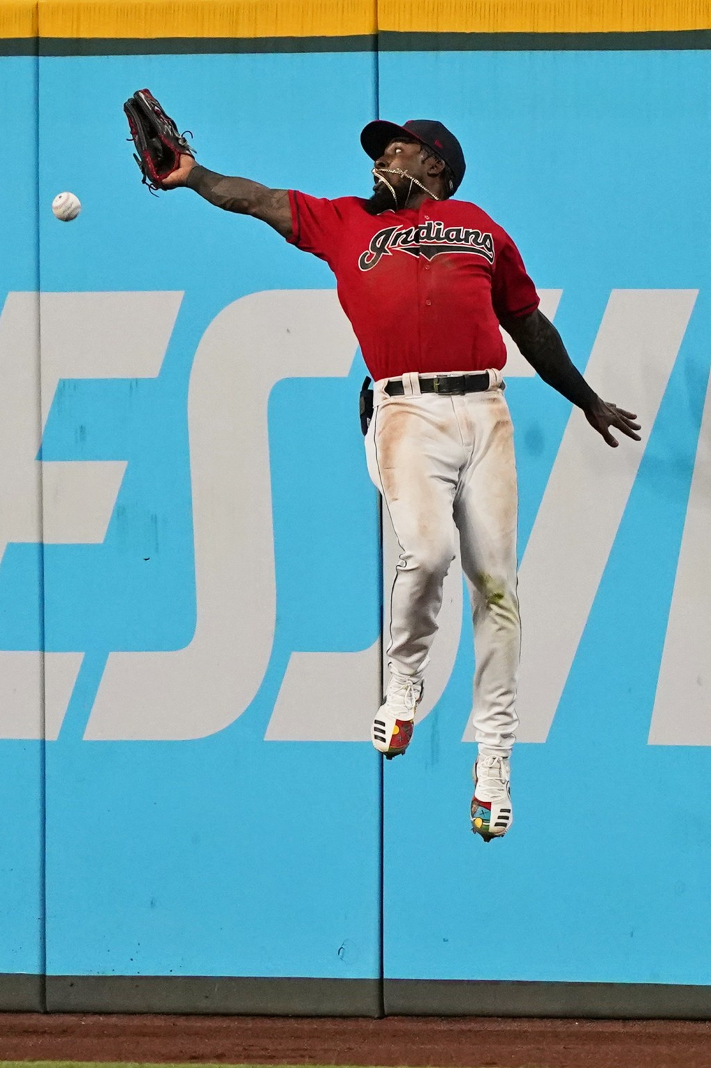 Cleveland Indians' Daniel Johnson jumps but can't get to a triple hit by Tampa Bay Rays' Francisco Mejia during the seventh inning of a baseball game ...