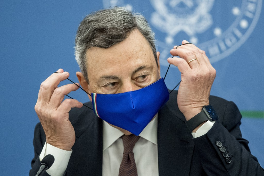 Italian Premier Mario Draghi attends a press conference at Chigi Palace government office in Rome, Thursday, July 22, 2021. With COVID-19 cases rising...