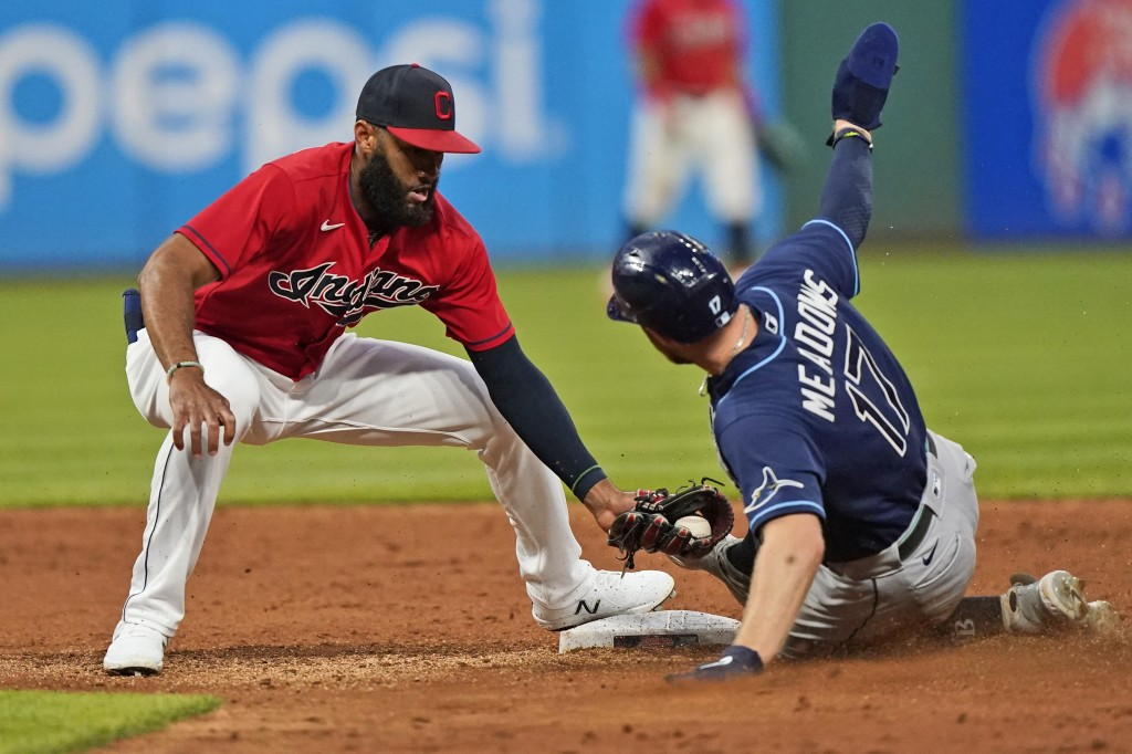 Cleveland Indians' Amed Rosario, left, tags out Tampa Bay Rays' Austin Meadows at second base on a steal attempt during the sixth inning of a baseball...
