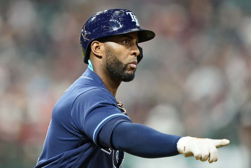 Tampa Bay Rays' Yandy Diaz points as he runs the bases after hitting a solo home run in the ninth inning of a baseball game against the Cleveland Indi...