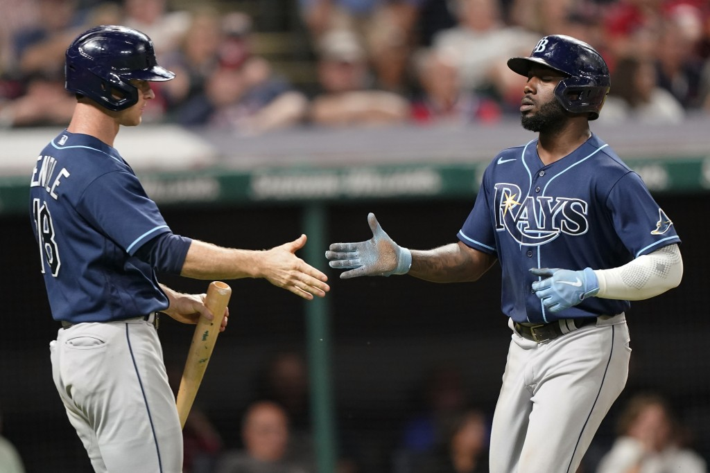 Tampa Bay Rays' Randy Arozarena, right, is congratulated by Joey Wendle after Arozarena scored in the 10th inning of the team's baseball game against ...