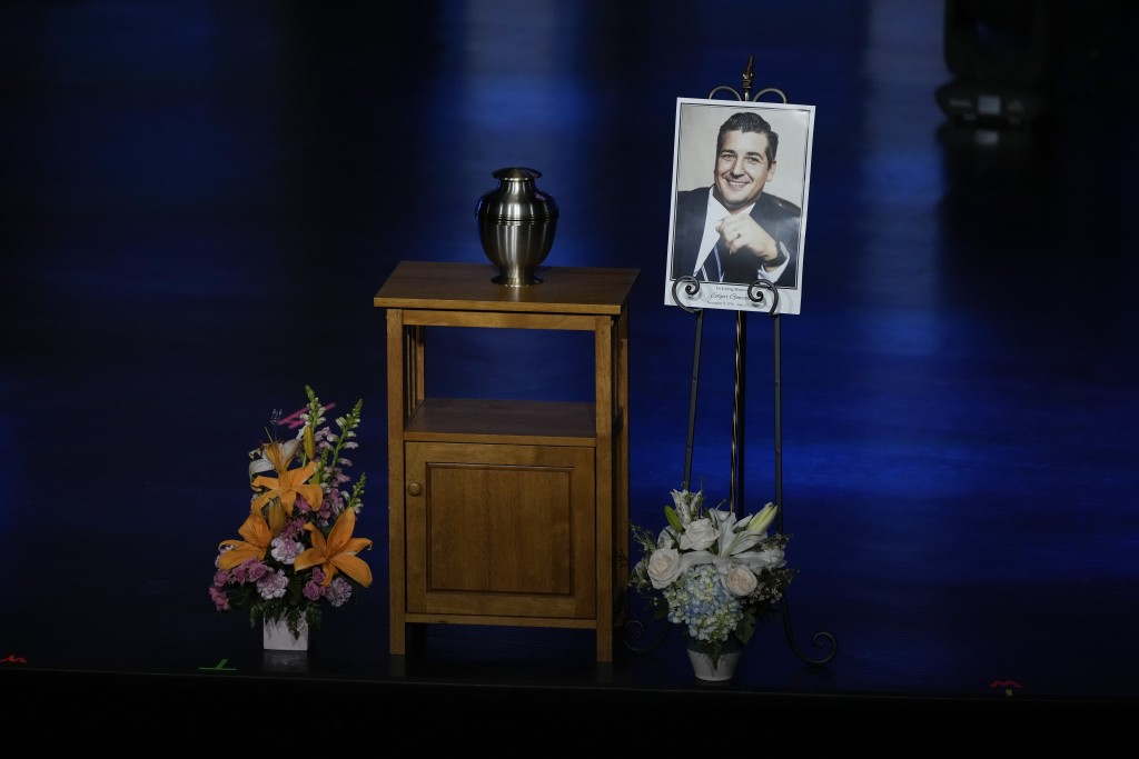 A portrait of Edgar Gonzalez, 44, who was killed last month in the Champlain Towers South condominium collapse, is displayed next to his urn during a ...