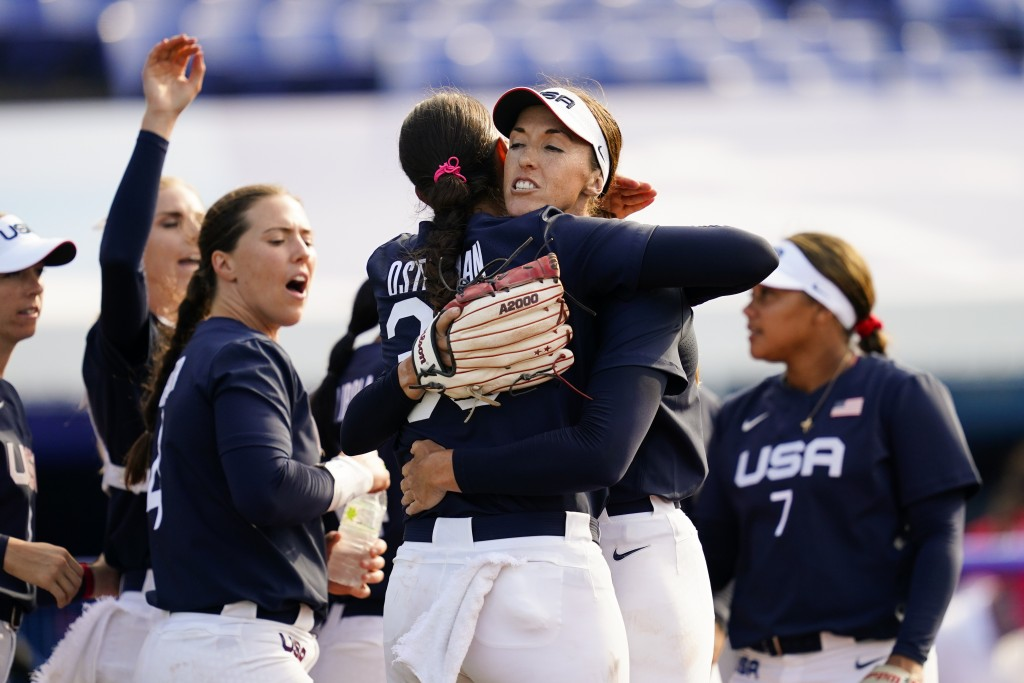 United States' Monica Abbott, center right, and Cat Osterman, center left, embrace defeating Mexico during a softball game at the 2020 Summer Olympics...