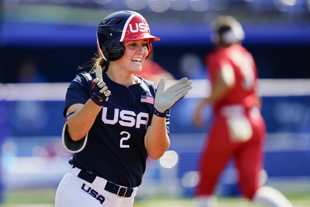 United States' Ali Aguilar reacts after hitting a two run single off of Mexico's Danielle O'Toole in the third inning of a softball game at the 2020 S...