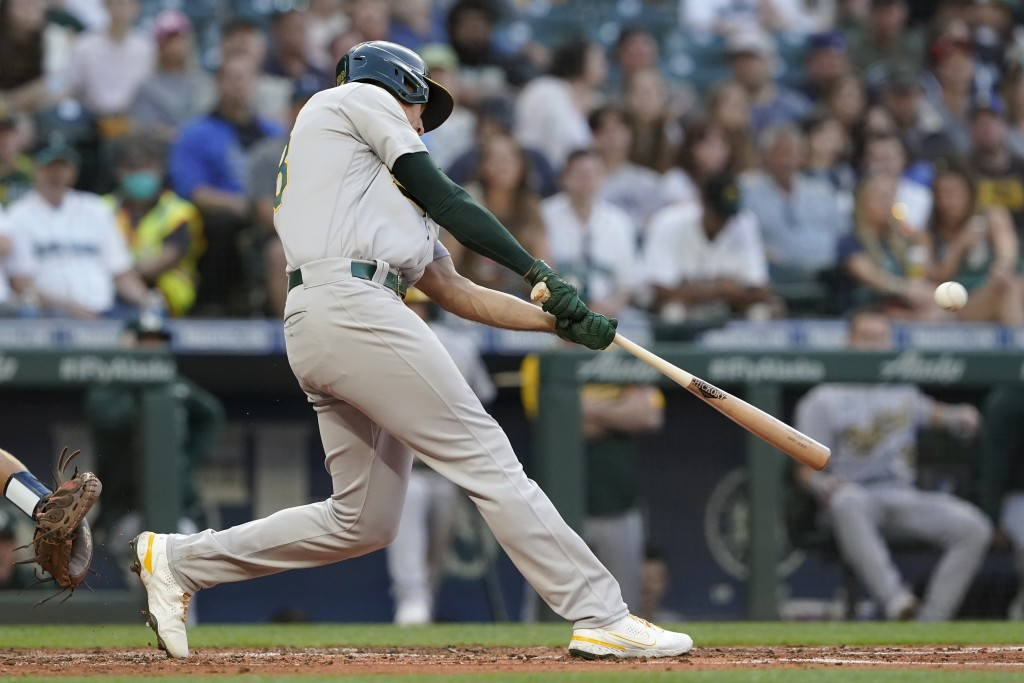 Oakland Athletics' Matt Olson hits a solo home run during the fourth inning of the team's baseball game against the Seattle Mariners, Friday, July 23,...