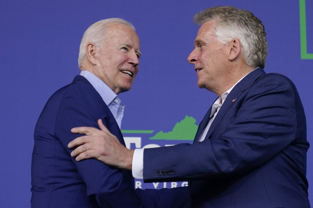 President Joe Biden greets Virginia democratic gubernatorial candidate Terry McAuliffe as he arrives to speak at a campaign event for McAuliffe at Lub...
