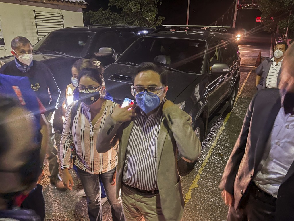 The special Prosecutor's Office Against Impunity,  Juan Francisco Sandoval, center, enters to Las Chinamas, El Salvador, on the border with Guatemala,...