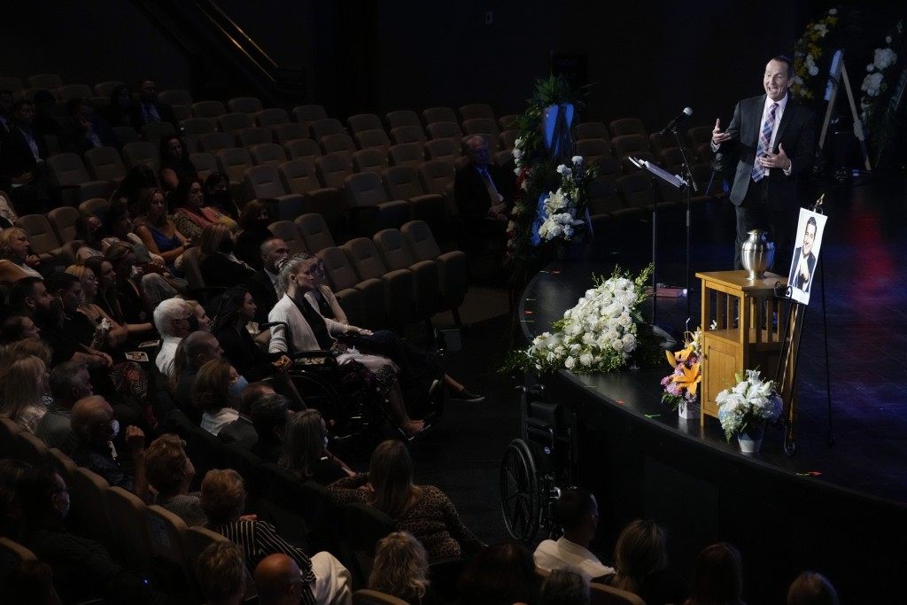 Pastor Don Robson speaks to mourners during a funeral service for Edgar Gonzalez, who was killed last month in the Champlain Towers South condominium ...