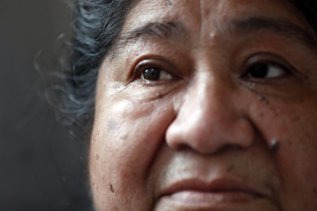 Maria Elena Estamilla, 62, sheds tear while sharing her struggle of remaining without an insurance, Wednesday, June 30, 2021, at her house in Chicago'...