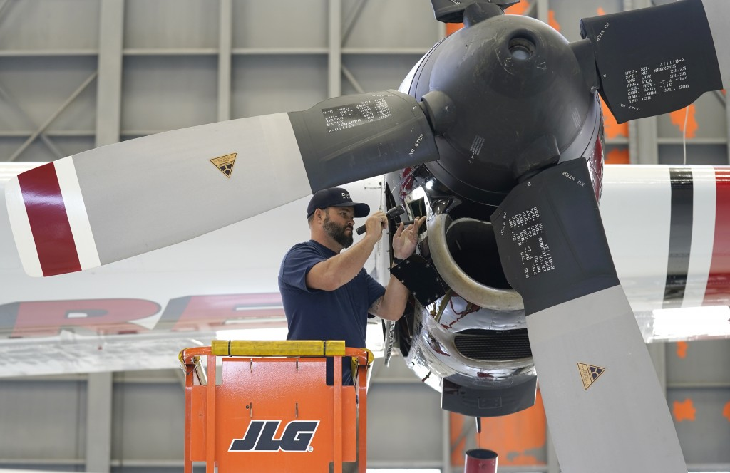 Aircraft Mechanic Cody Poole inspect one of the engines on a recently acquired C-130 aircraft, that will be used for firefighting, hangared at the Cal...