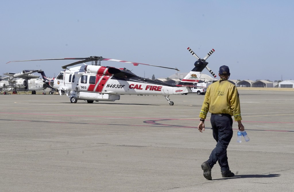 A Sikorsky Firehawk helicopter sits on the tarmac at the California Department of Forestry and Fire Protection's Sacramento Aviation Management Unit b...