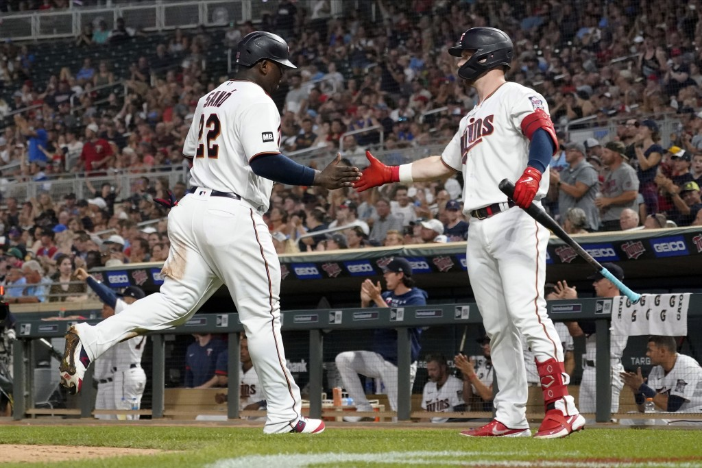Minnesota Twins' Ryan Jeffers, right, congratulates Miguel Sano after Sano scored on a hit by Nick Gordon off Los Angeles Angels relief pitcher Steve ...