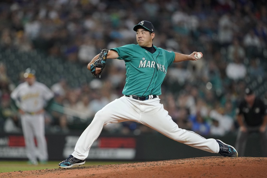 Seattle Mariners starting pitcher Yusei Kikuchi throws to an Oakland Athletics batter during the sixth inning of a baseball game Friday, July 23, 2021...