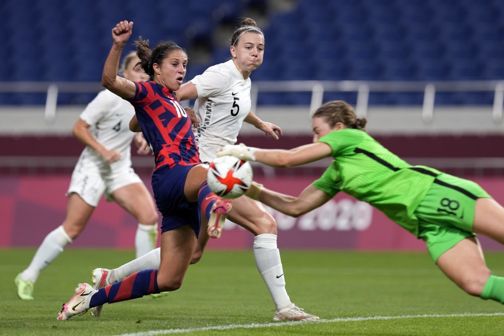 New Zealand's goalkeeper Anna Leat (18) makes a save against United States' Carli Lloyd (10) during a women's soccer match at the 2020 Summer Olympics...