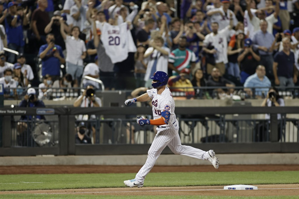 New York Mets' Pete Alonso celebrates as he rounds third base after hitting a solo home run against the Toronto Blue Jays during the eighth inning of ...