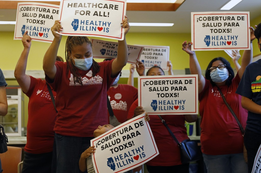 Members of Health Illinois coalition celebrate the extension of state health insurance coverage to older immigrants, ages 55 and over, living in the c...
