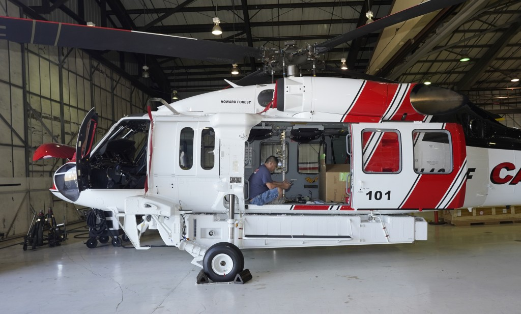 Avionics mechanic Mike Luong works on a Sikorsky Firehawk helicopter at the California Department of Forestry and Fire Protection's Sacramento Aviatio...