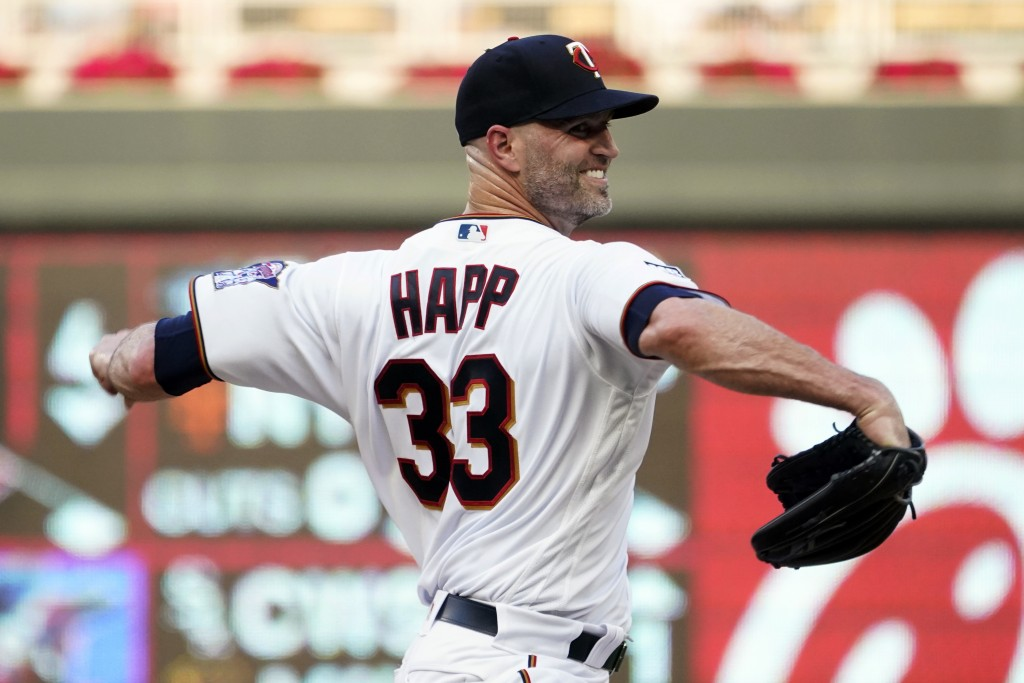 Minnesota Twins pitcher J.A. Happ throws to a Los Angeles Angels batter during the first inning of a baseball game, Friday, July 23, 2021, in Minneapo...